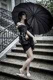 Japanese look, pretty young woman with black umbrella, under aut Royalty Free Stock Photography
