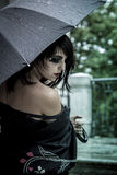 Japanese look, pretty young woman with black umbrella, under aut Stock Photography