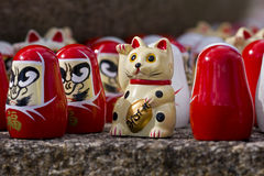 Japanese lucky cat. Figurine and wish doll stock image
