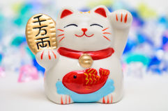 JAPANESE LUCKY CAT FIGURINE. A Japanese lucky cat figurine royalty free stock photo