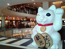 Japanese lucky cat or welcoming cat ( Maneki Neko ) Royalty Free Stock Photo