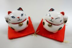 Japanese lucky charm manekineko. Japanese maneki-neko is a common lucky charm which is often believed to bring good luck to the owner stock photos