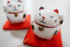 Japanese lucky charm manekineko. Japanese maneki-neko is a common lucky charm which is often believed to bring good luck to the owner stock images