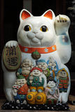 Japanese lucky fortune cat. With seven fortune Buddha.The words on right hand of cat means lucky and the word on bell means fortune and the words on the left royalty free stock photo