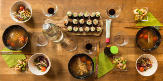 Japanese lunch. Sushi, shrimp salad with broad beans, soup, set table royalty free stock image