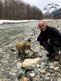 Japanese macaque and tourist in the Kamikochi National Park Royalty Free Stock Image