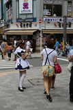 Japanese Maid Distributing Flyers Stock Images