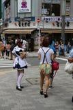 Japanese Maid Distributing Flyers Stock Photos