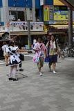 Japanese Maid Distributing Flyers Stock Photo