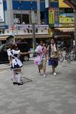 Japanese Maid Distributing Flyers Royalty Free Stock Image