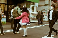 Japanese maid girl handing out flyers to people in Akihabara, Tokyo, Japan stock photos
