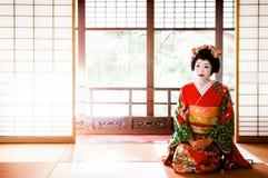 Japanese Maiko, Geisha in red costume sit in Tatami floor room w. JAN 23, 2014 : Sakata, Yamagata, Japan : Japanese Maiko, Geisha in red costume, traditional Stock Photography
