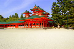 Japanese majestic temple. Ornate Orange temple stands on pure white gravel Royalty Free Stock Photography