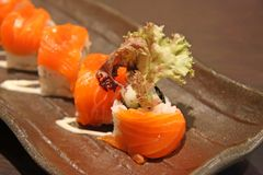 Japanese maki. Row of maki, japanese seafod rice rolls Stock Photography
