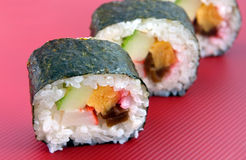 Japanese Maki Roll. Japanese Maki (Roll) type sushi with crab, egg and cucumber royalty free stock photos
