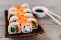 Japanese maki sushi rolls on original clay plates Royalty Free Stock Photography
