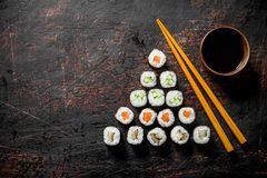 Japanese Maki sushi with salmon, cucumber and chicken. On dark rustic background stock image