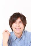 Japanese man dreaming at his future Royalty Free Stock Image