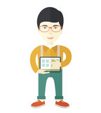 Japanese Man holding a screen tablet Stock Photography