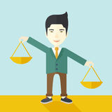 Japanese man holding a weighing scale Royalty Free Stock Image
