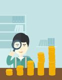 Japanese man looking at his growing business using. A japanese man looking his growing business in financial crisis concept. Economy and money, coin and success Royalty Free Stock Photography