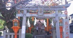 Japanese man prays at the shrine stock footage