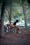 Japanese man siting for relaxing in a park Royalty Free Stock Photography