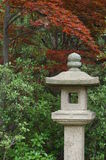 Japanese Maple Tree and Statue Royalty Free Stock Photography
