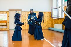 Japanese martial art of fighting the sword. School for children and adults. Sport stock photos