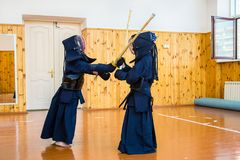 Japanese martial art of fighting the sword. School for children and adults. Sport stock images