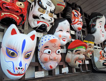 Japanese Masks in Nakamise Street. Traditional style masks sold along Nakamise Street near between the two main gates of the Senso-ji Temple in Asakusa, Tokyo Royalty Free Stock Photo