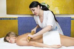 Japanese massage with bamboo sticks Royalty Free Stock Image