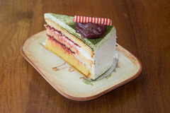Japanese Matcha Green tea cake with red bean jam topping in vint Royalty Free Stock Photography