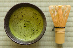 Japanese Matcha Tea. Japanese Matcha green tea in a chawan or traditional ceramic bowl with a chasen or bamboo whisk stock photography
