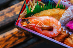 Japanese meal (Bento) in paper boxes Royalty Free Stock Photography