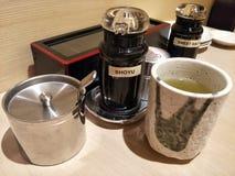 Japanese meal. Japanese ocha green tea, shoya sauce, sweet sauce, wasabi container Royalty Free Stock Photography