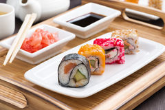 Japanese meal - sushi and rolls on white plate Royalty Free Stock Image