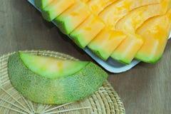 Japanese melon slide fruit background. On wood table Royalty Free Stock Image