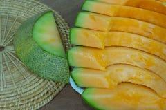 Japanese melon slide fruit background. On wood table Stock Images