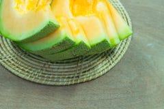 Japanese melon slide fruit background. On wood table Stock Photo