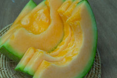 Japanese melon slide fruit background. On wood table Stock Photography