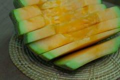 Japanese melon slide fruit background. On wood table Royalty Free Stock Photos