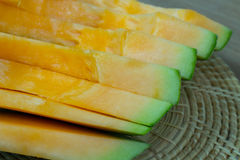 Japanese melon slide fruit background. On wood table Royalty Free Stock Images