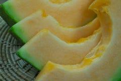 Japanese melon slide fruit background. On wood table Royalty Free Stock Photo