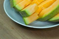 Japanese melon slide fruit background. On wood table Royalty Free Stock Photography