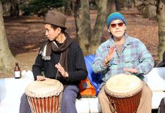 Japanese men practicing on the bongos in the park Tokyo Stock Photo
