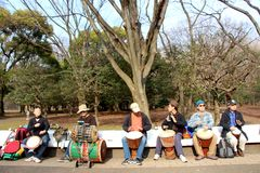 Japanese men practicing on the bongos in the park Tokyo Stock Image