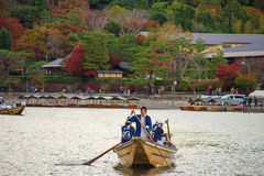 Japanese men sail boat for tourist at Arashiyama Stock Image