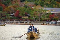 Japanese men sail boat for tourist at Arashiyama Stock Image