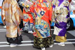 Japanese young men wearing traditional Kimono. Japanese men wearing traditional kimono for the coming of age day celebration Stock Images